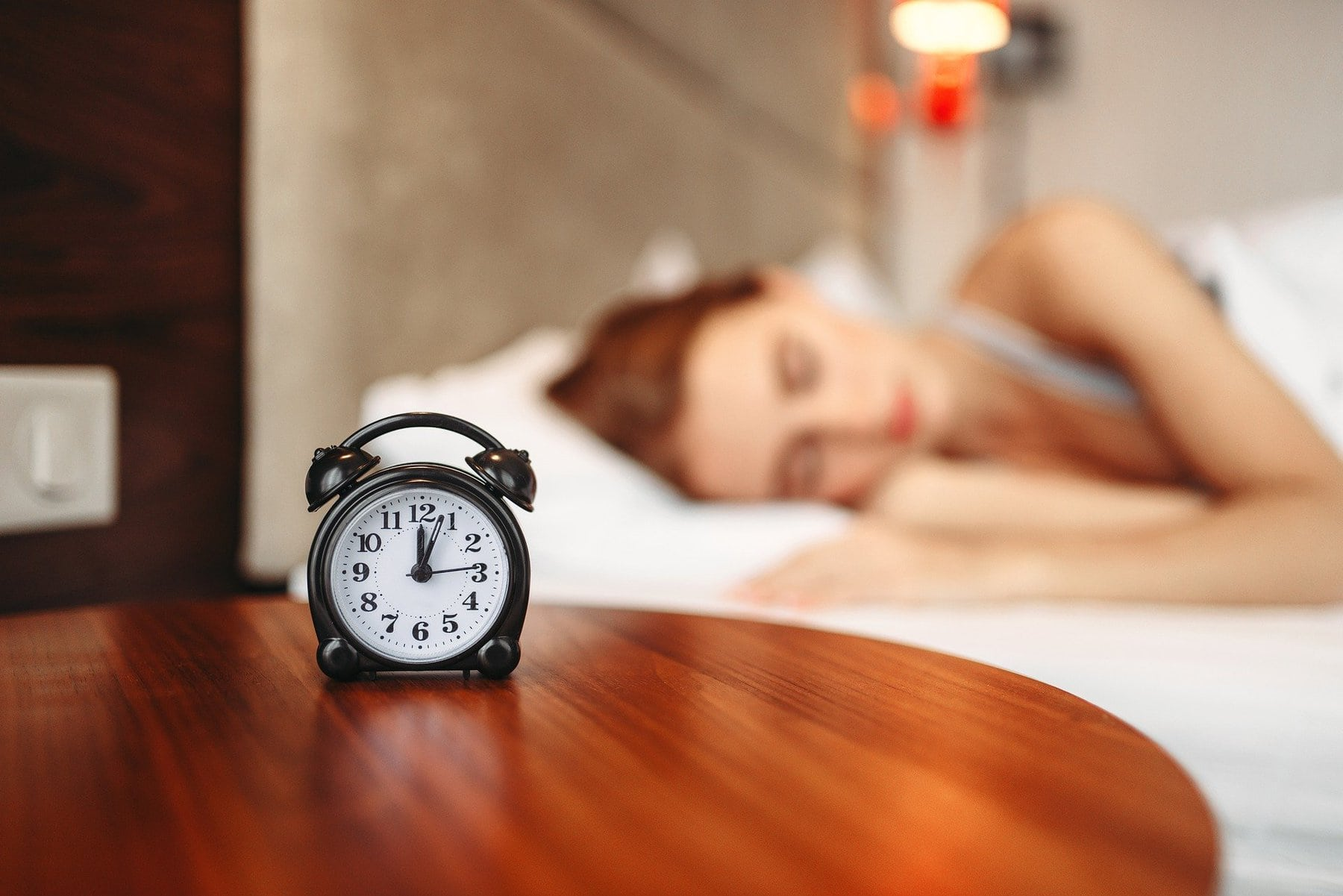 women wake up to alarm clock