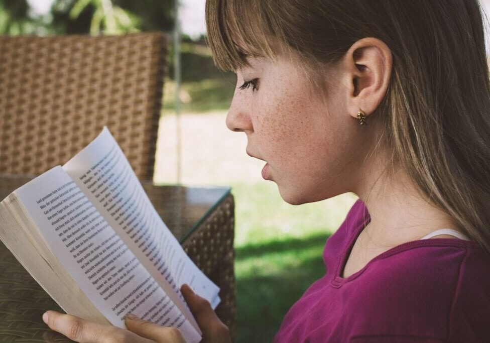 girl focusing on a book